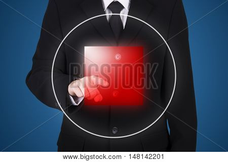 businessman press on stop button blue background