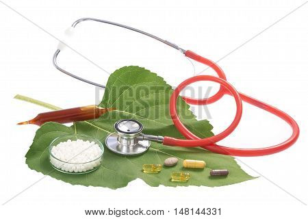 Alternative medicine herbs and stethoscope on white background