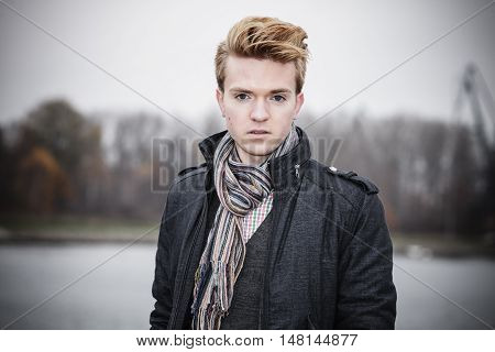 Portrait of young handsome man fashion model casual style on street outdoors
