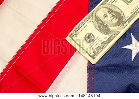 American dollars on the flag of United Stated of America.