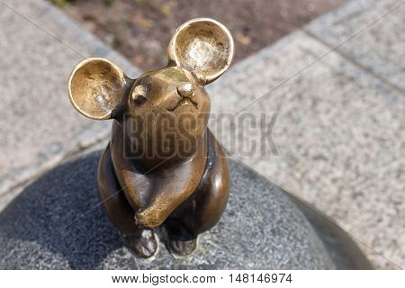 LITHUANIA, KLAIPEDA - MAY 25, 2014: Sculpture Wonderful little mouse is oldtown Klaipeda. Lithuania. One of the most famous sculptures in the city.