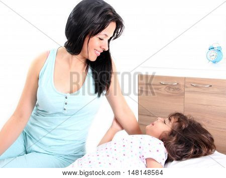 mother and daughter in the room at bedtime