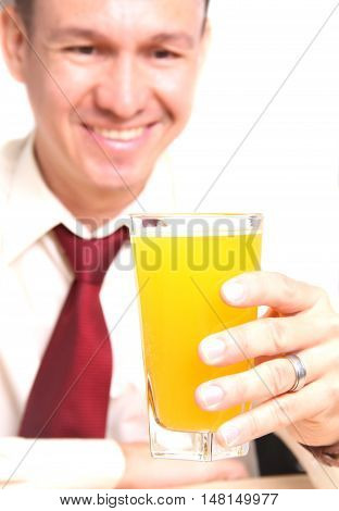 man in the dining room drinking juice