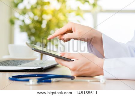 Doctor Touch Digital Tablet To Check Patient's Medical Case