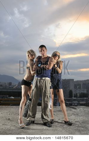 two woman and one man together in small gorup team