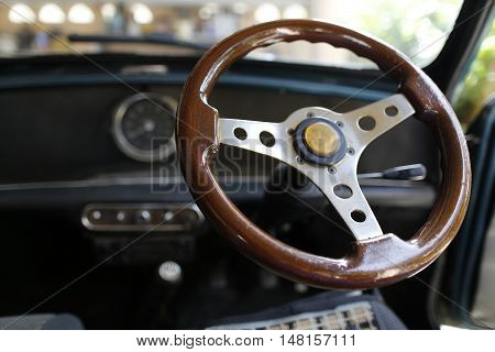 MALAYSIA - August 15, 2016: A classic car Mini Austin 850 interior and steering is photographed in Malaysia, August 15, 2016.