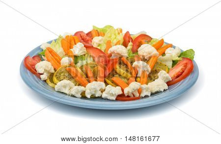 Colorful mixed vegetables with sauteed squash on a light blue plate, on white