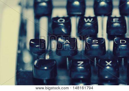 Up close shot of blue hued old vintage typewriter