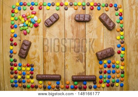 Beautiful Candies On A Wooden Background