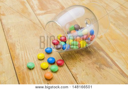 Multi-colored Candies On A Wooden Background