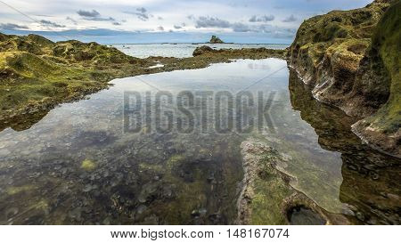 Coral and stones in low tide ocean water at Labuan Pearl of Borneo,Malaysia.