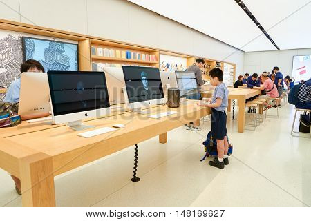 HONG KONG - CIRCA SEPTEMBER, 2016: inside of Apple store. Apple Store is a chain of retail stores owned and operated by Apple Inc., dealing with computers and consumer electronics.