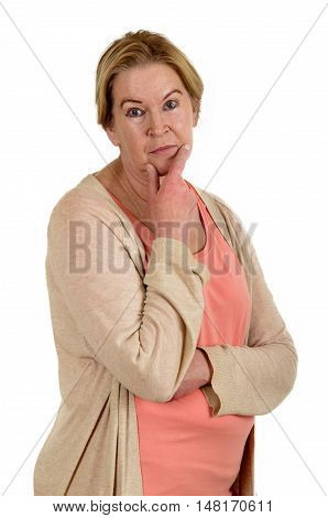 blonde senior female looks thoughtfully in a camera isolated on white background