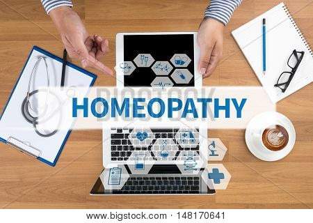 HOMEOPATHY Doctor touch digital tablet desktop with medical equipment on background top view coffee