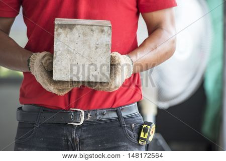 Technician checking of concrete quality during cube demolition