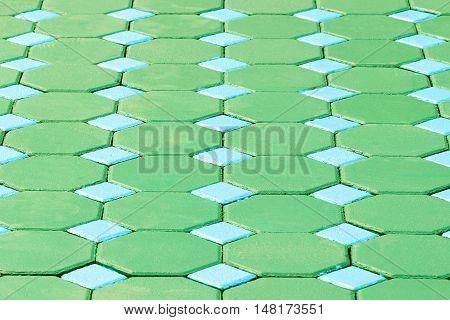 The hexagonal brick flooring texture background .
