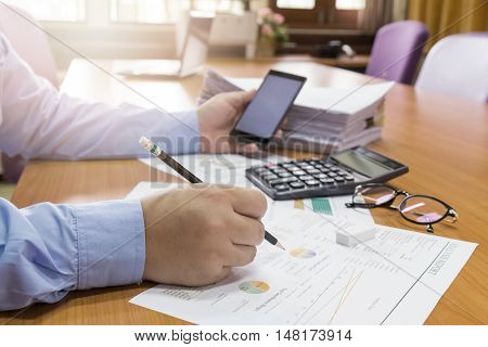 Close up Business man working with paperwork