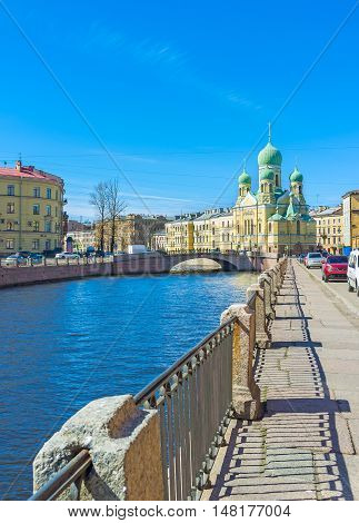 The Griboedov Canal embankment is the nice place to walk and enjoy the view on St Isidore of Juriev Estonian Orthodox Church St Petersburg Russia.