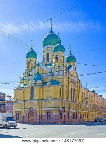 The bright yellow facade of St Isidore of Juriev Church located in Lermontovsky Prospekt St Petersburg Russia.