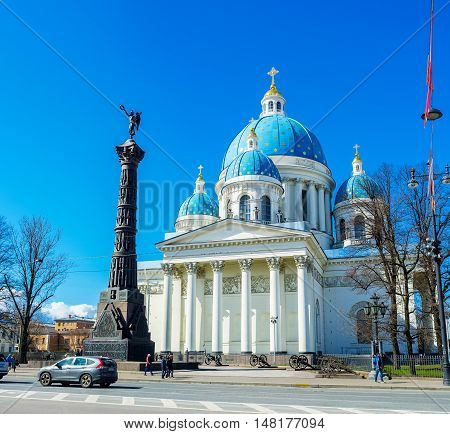 ST PETERSBURG RUSSIA - APRIL 25 2015: The Victory Column with the Goddess Nike on the top at the facade of Trinity Cathedral in Izmailovsky Prospekt on April 25 in St Petersburg.