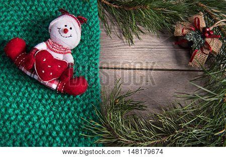 Christmas tree decoration snowman wooden texture background woolen warm wear new year green