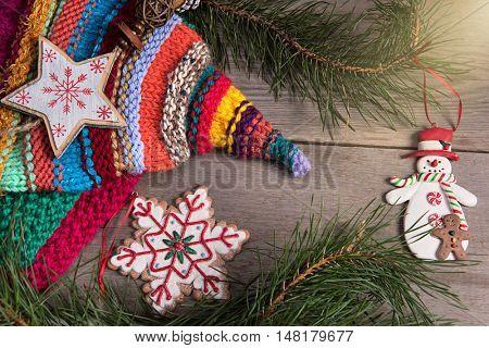 Christmas tree decoration snowman wooden texture background woolen warm wear new year woolen hat