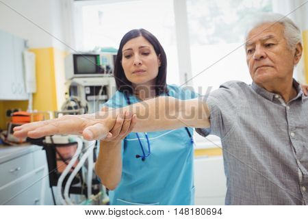 Female doctor examining a patient at the hospital