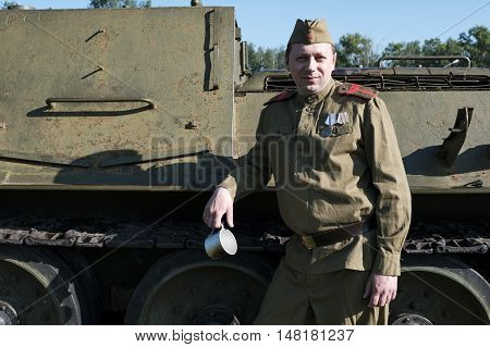 Soldier  around the tank. Reconstruction of the War of 1941-1945