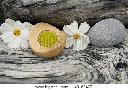nature driftwood wood and handmade candle with gray stone,gerbera
