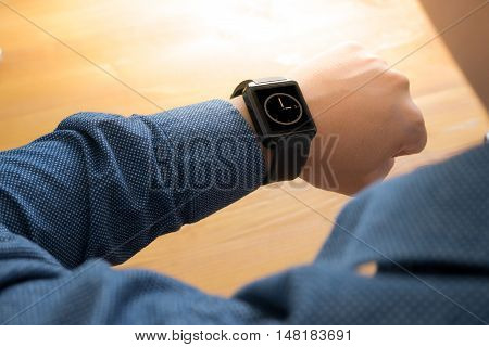 Man Hand Wearing Elegant Smartwatch