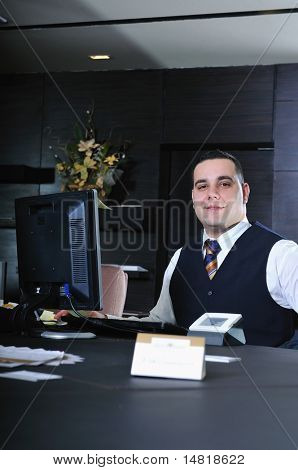 reception service man hotel indoor smile travel