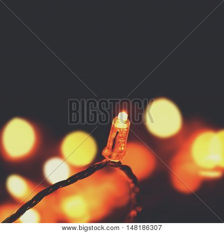 Glowing light bulbs design - Christmas lights garland with copy space. night lights