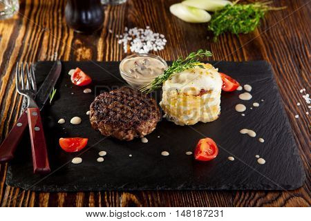 Beef Steak with Mashed Potato and Mushrooms Sauce