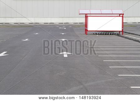 Mock up. Shopping cart return point on empty parking lot near supermarket