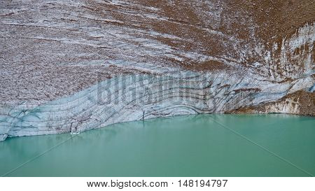Glacier ice layers and green alpine lake. Jasper National Park. Canadian Rockies. Alberta. Canada.