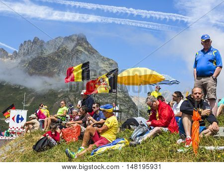 Col du Glandon France - July 23 2015: Image of unidentified fans waiting for the apparition of the cyclists on Col du Glandon in Alps during the stage 18 of Le Tour de France 2015.