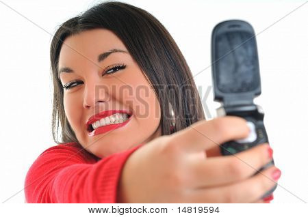 young business woman in red isolated on white talking on cell phone