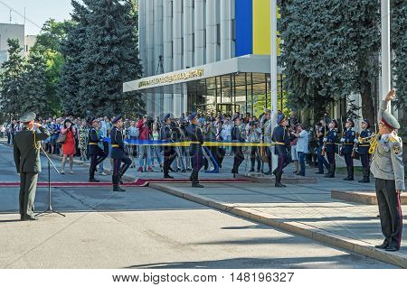 Dnepropetrovsk Ukraine - August 23 2015: Ceremony of raising the national flag near the building of the regional state administration