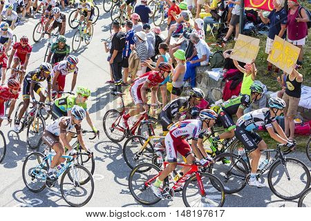 Col du Glandon France - 23 July 2015: The peloton riding on the road to Col du Glandon in Alps during the stage 18 of Le Tour de France 2015.