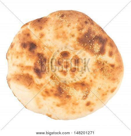 White bread. The Uzbek flat cake on a white background. Top view.