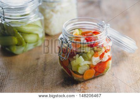 Pickled vegetables in glass jars
