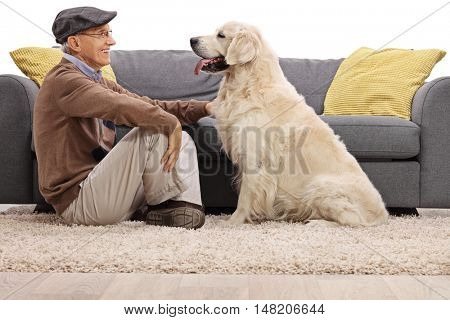 Senior and his dog sitting on the floor and looking at each other isolated on white background