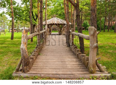 Wooden house with a bridge in the forest