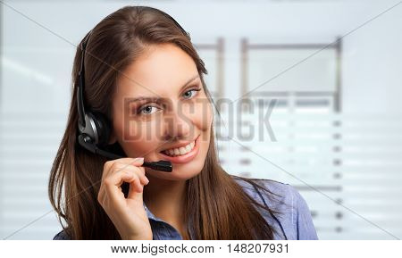 Portrait of a gorgeous woman using an headset