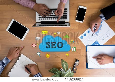 Business Team Hands At Work With Financial Reports And A Laptop, Seo Concepts