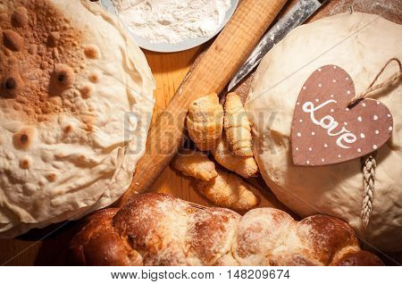 Variety of bakery products on a wooden table