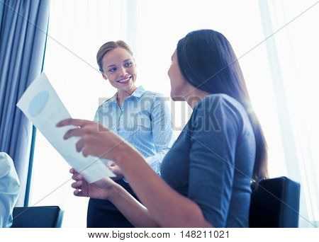 business, people and teamwork concept - smiling businesswomen meeting in office