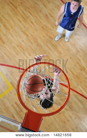 competition cencept with people who playing basketball in school gym