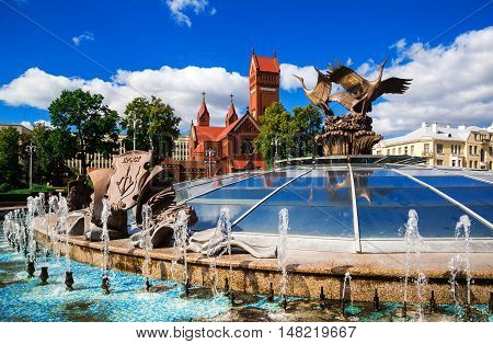 Church of St. Simon and Alena on Independence Square in Minsk on the background of a fountain