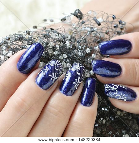 Female hands nails with beautiful art manicure